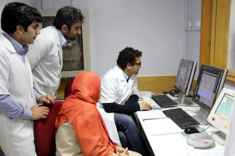 Dr Arshid Azarine and his medical team working on computers