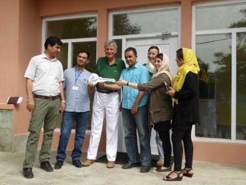 Group of people holding they key to the Zanjir e Omed's House